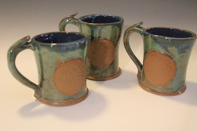 Embossed Celtic mugs